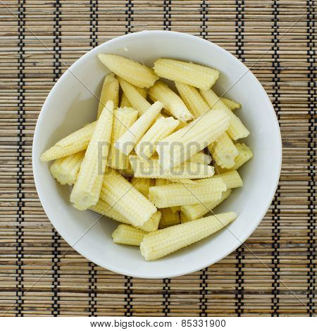 A Side View Of A Dish Of Canned And Sliced Corn Nuggets And Ends