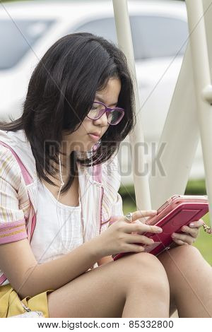 Thai Girl Relaxing With Digital Tablet
