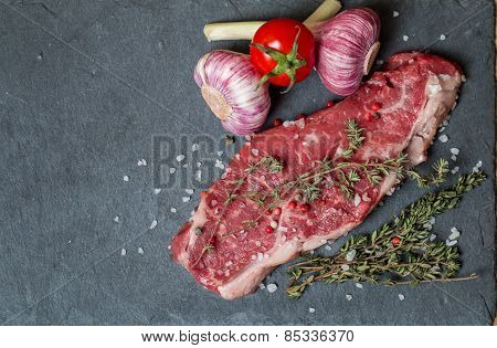 Raw Meat Steak With Fresh Herbs And Salt