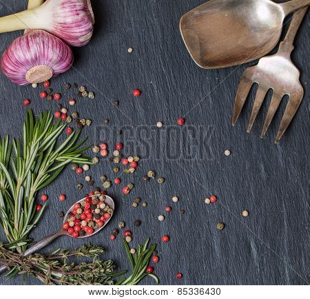 Spoons With Spices And Herbs On  Black