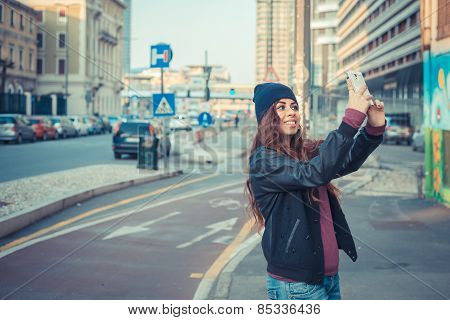 Beautiful Girl Taking A Selfie In The City Streets