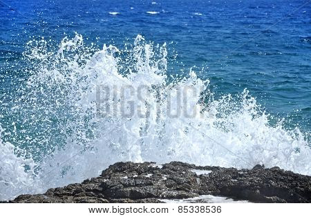 Rocky Coast With Splashing Waves