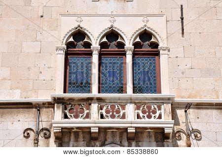 Venetian Windows And Balcony