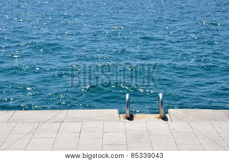 Pier With Stairs On The Sea