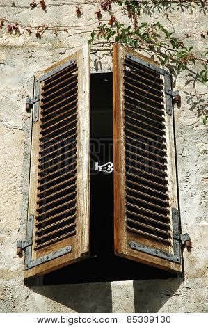 Partly Opened Wooden Window Shutters