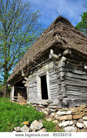 Traditional Romanian Wooden Barn With Thatched Roof
