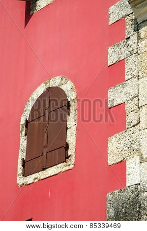 Old Window On A Red Wall