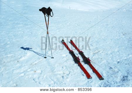 Skis And Poles In The Snow On A Winter Day