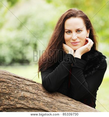 young woman with long hair in summer park