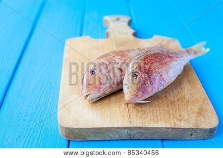 Raw red mullet on board