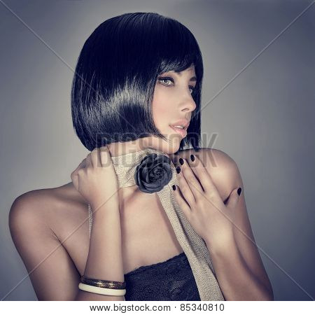 Portrait of sexy woman isolated on gray background, retro style fashion look, gorgeous hairdo and stylish makeup, luxury beauty salon