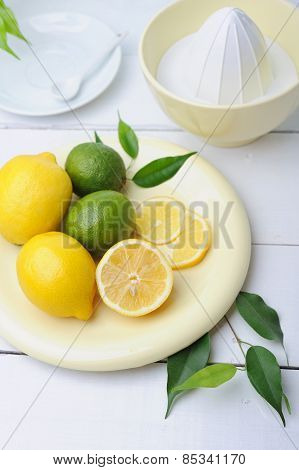 Citrus squeezer and fresh lemons being used to make fresh lemonade