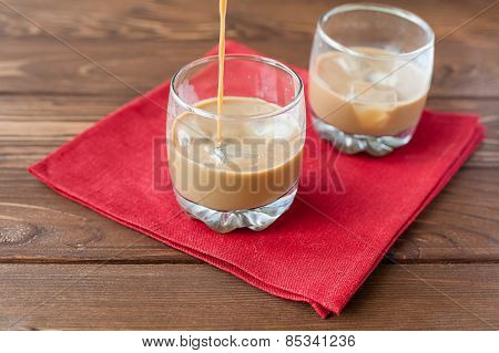 Coffee liqueur pouring in glass