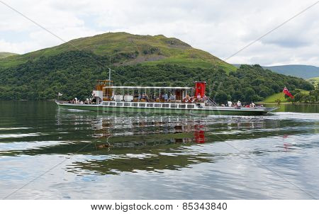 Warm calm summer weather on Monday 30th June 2014 brought visitors to Ullswater Lake District, to ta