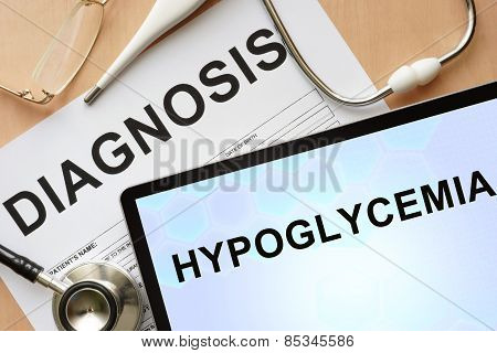 Tablet with diagnosis hypoglycemia and stethoscope.