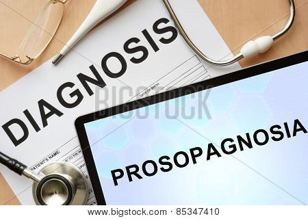 Tablet with diagnosis prosopagnosia and stethoscope.