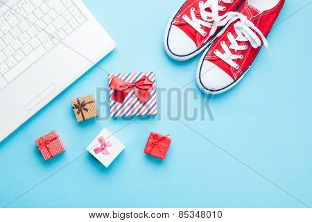 White Computer And Gumshoes With Gifts