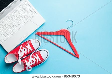 White Computer And Gumshoes With Hanger
