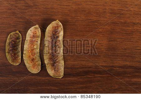 The  Alexandrian Senna Pod On The Wood
