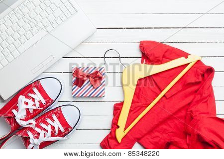 White Computer And Gumshoes With Clothes