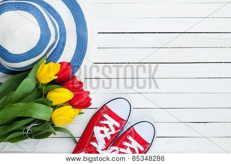 Bouquet Of Tulips And Gumshoes With Blue Hat