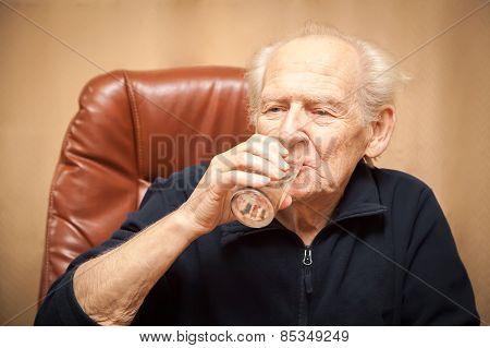 Old Man Drinking Water