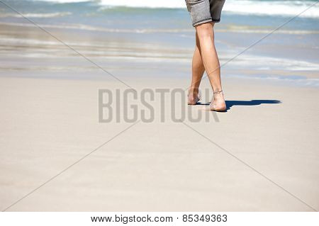 Man Walking Barefoot On Vacation At The Beach