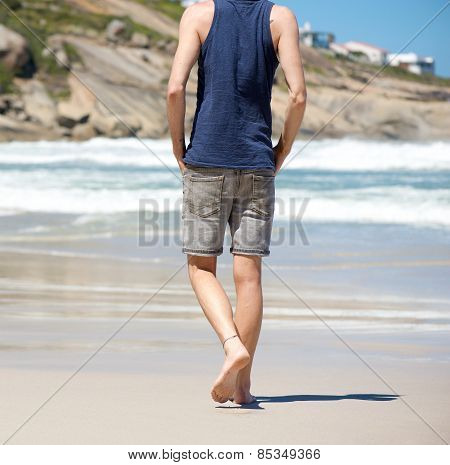 Walking Barefoot Alone On Beach While On Vacation