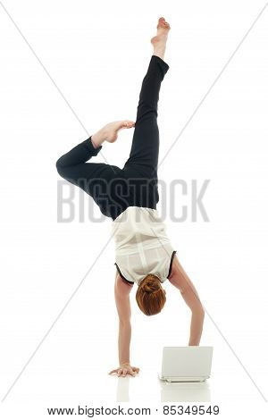 Acrobat with laptop. Concept of overemployment