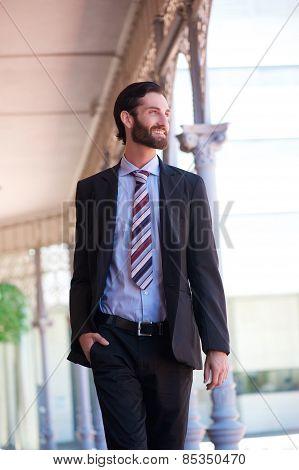 Modern Smiling Business Man Walking Outdoors