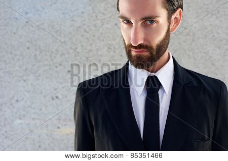 Male Fashion Model In Black Suit And Tie