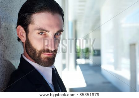 Close Up Portrait Of A Serious Male Fashion Model With Beard