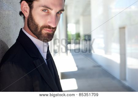 Cool Young Businessman With Beard Posing Outside