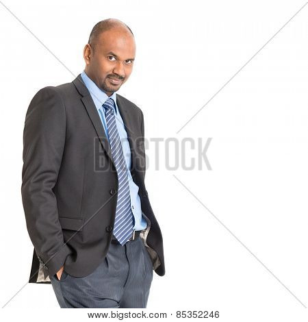 Indian businessman in formal suit looking at camera, isolated on white background.