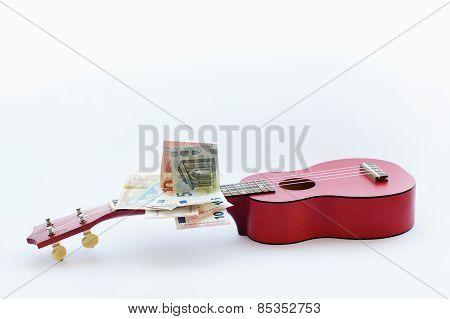 Small Guitar Ukulele And Euro Banknotes