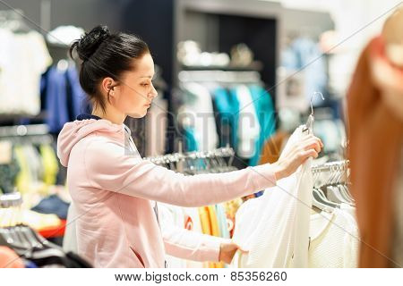 young woman choosing which dress wear
