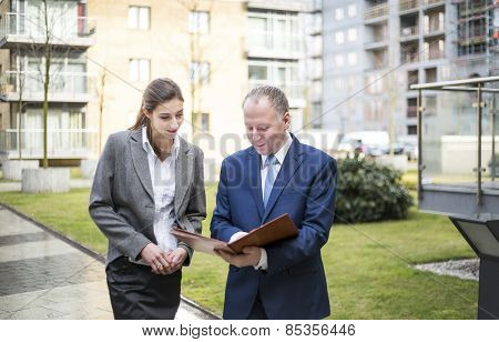 Two Business People Discussing Outside The Office