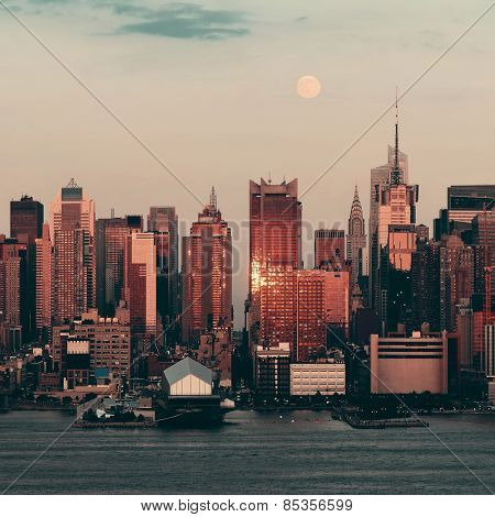 New York City skyscrapers urban view at sunset and moon rise.