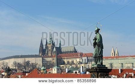 St. John Of Nepomuk Statue On Prague Castle Background.
