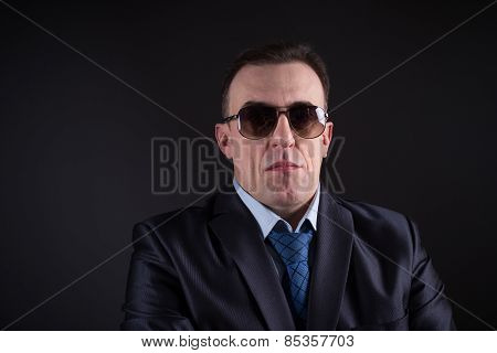 Confident businessman in sunglasses