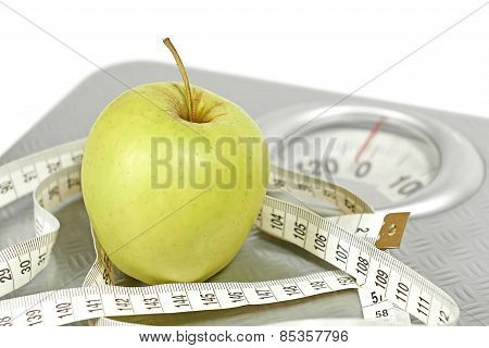 Weight scale with a measuring tape