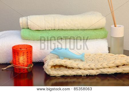 Towel Stack With Bast And Dolphin Form Soap.
