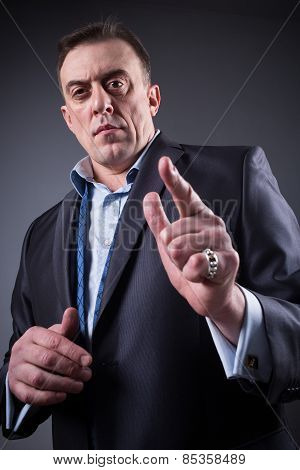 frightening man shows a finger,