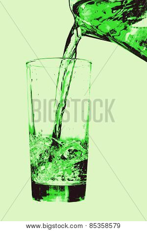 Jug Pouring To Glass On Green Background.
