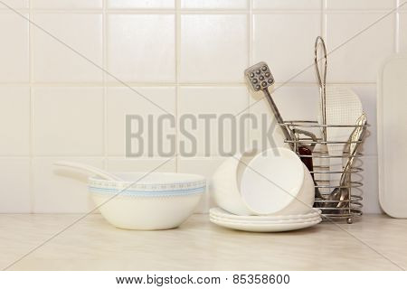 White Kitchenware On Kitchen Table.