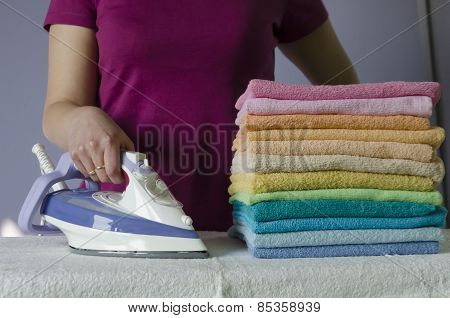 Ironing colorful towels