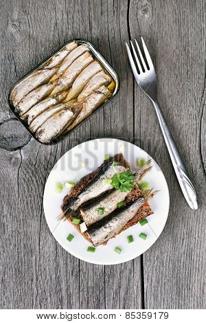 Sprats Sandwiches On Wooden Table