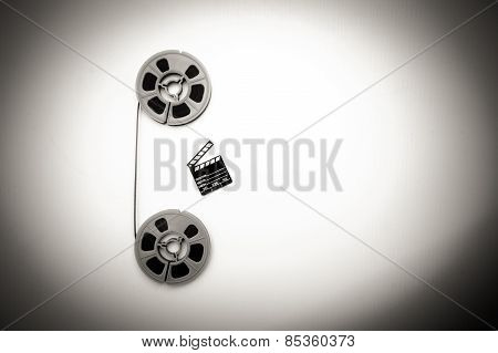 8mm Movie Reels And Little Clapper black and white