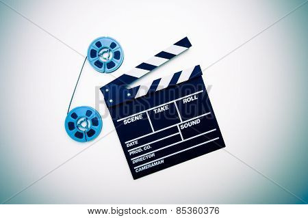 8mm Blue Movie Reels And Clapper Board vintage color effect