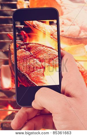 Using Smartphones To Take Photos Of Grilled Salmon Steak With Instagram Style Filter
